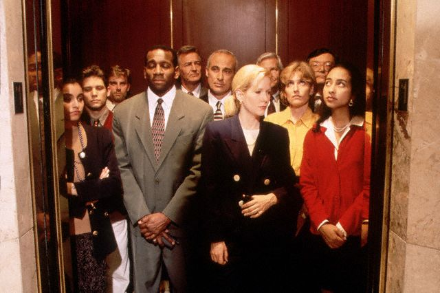 Executives crowded into elevator 1996